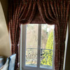 Italian strung curtains with Roman blind behind